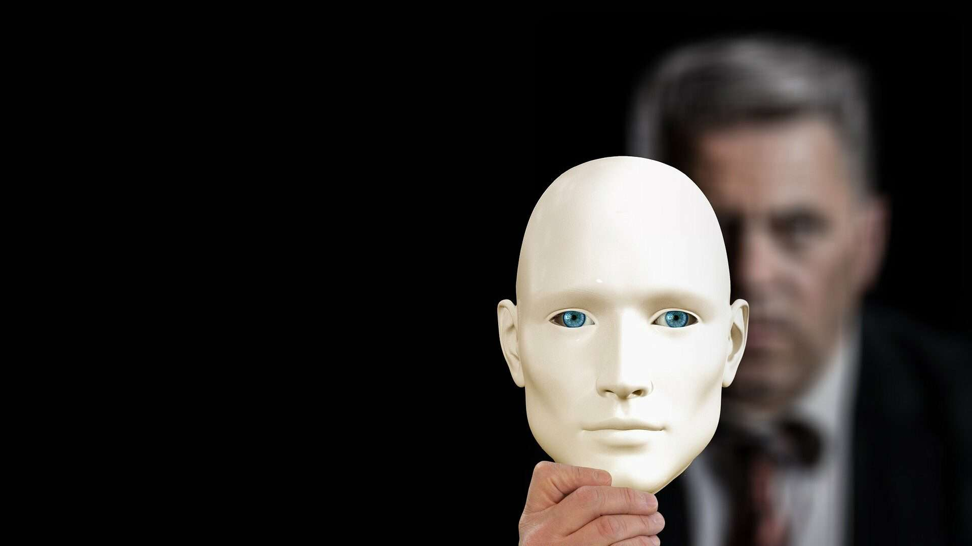 Businessman Holding Mask