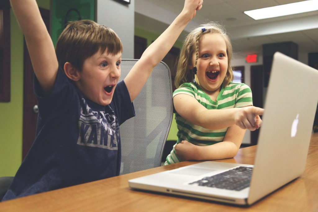 Children Win - Boy and Girl are Excited
