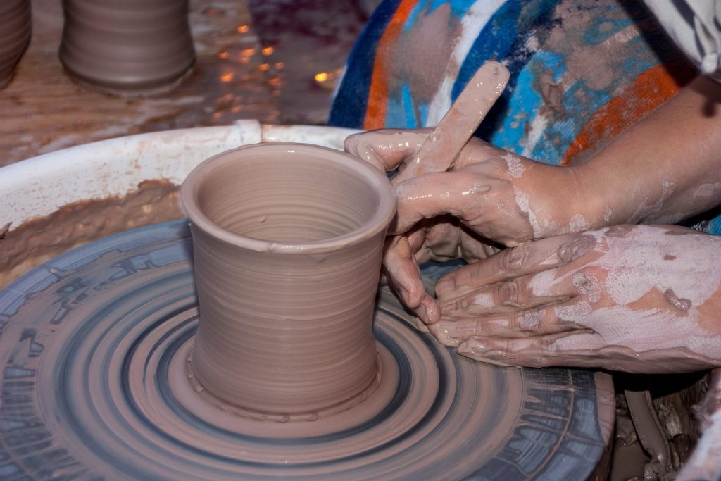 Potter and Clay Pot