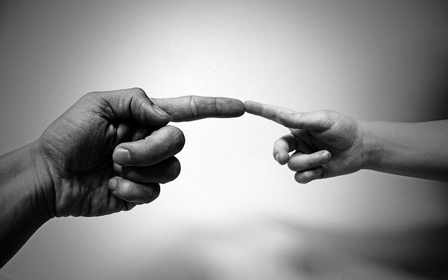 Come Close to God - Finger of Child and Finger of Parent Touched