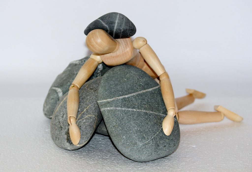 Crushed by Heavy Load - Wooden Man Under Stone