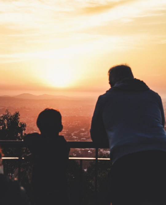 Father and Son Looking at the Sunrise
