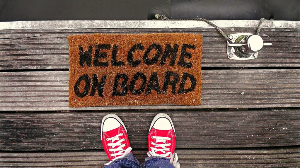 Feet on Dock - Welcome on Board Sign