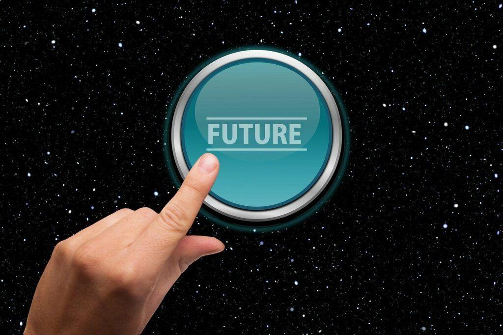 Finger Pressing on Button Written Future on It