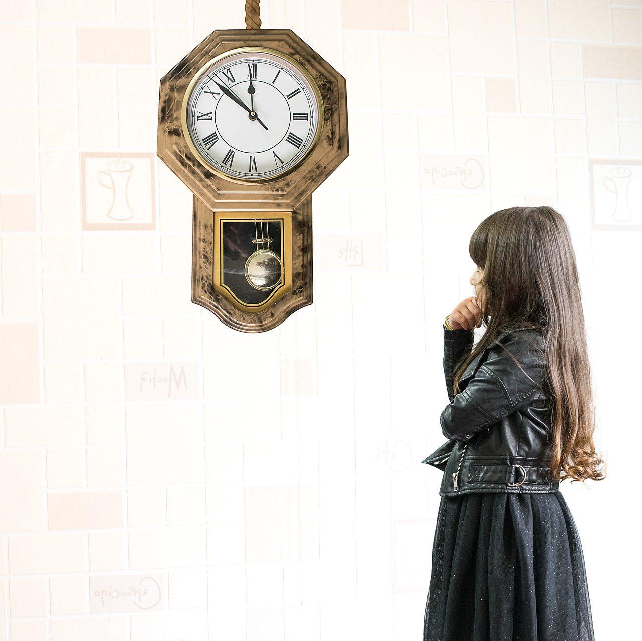 Girl Waiting Near Clock