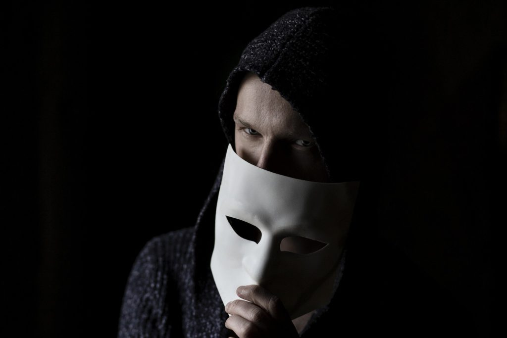 Hacker Holding Mask