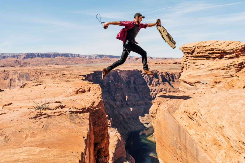 Man Jumps Over the Canyon