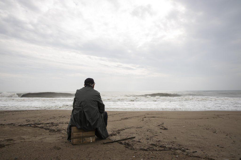 Man Meditating  - Looking at the Sea