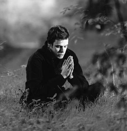 Man is Praying with Hands Folded