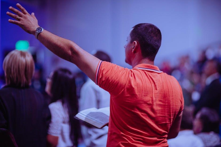 Man Raised Hand in Worship