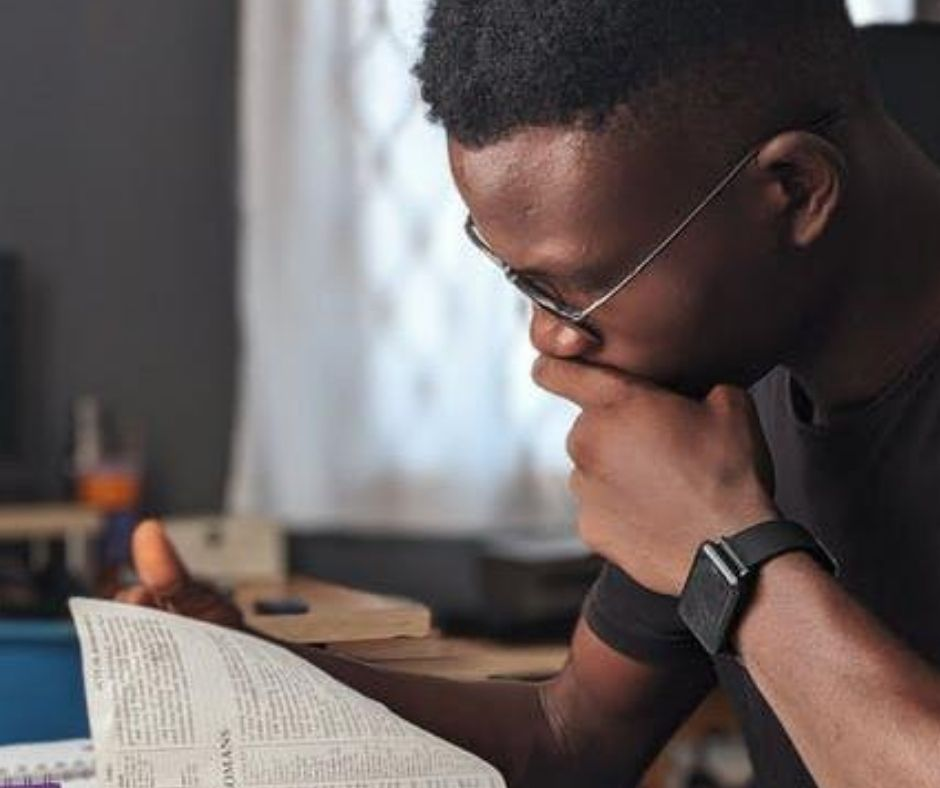 Man Studying the Bible and Thinking