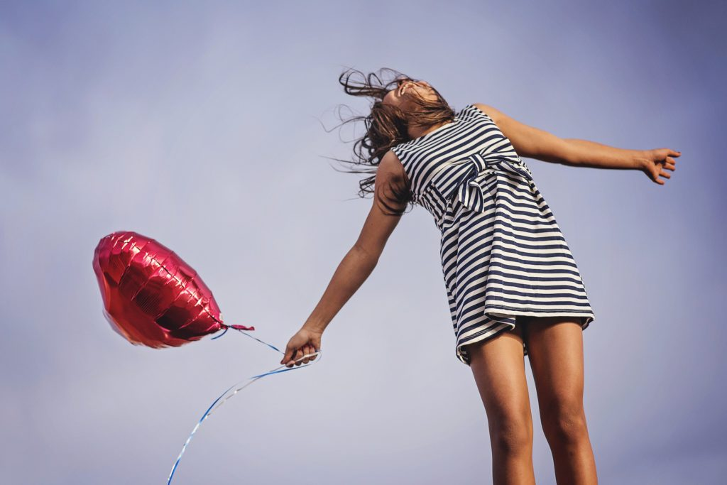Rejoice - Happy Woman with Red Balloon