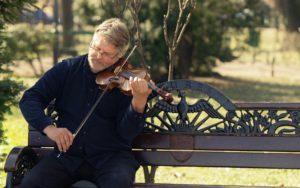 Talented Man Plays Violin