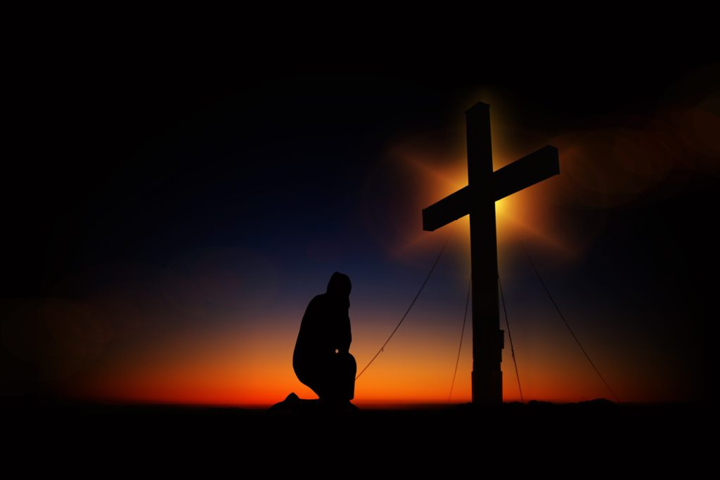 The Cross - Man Kneels Down