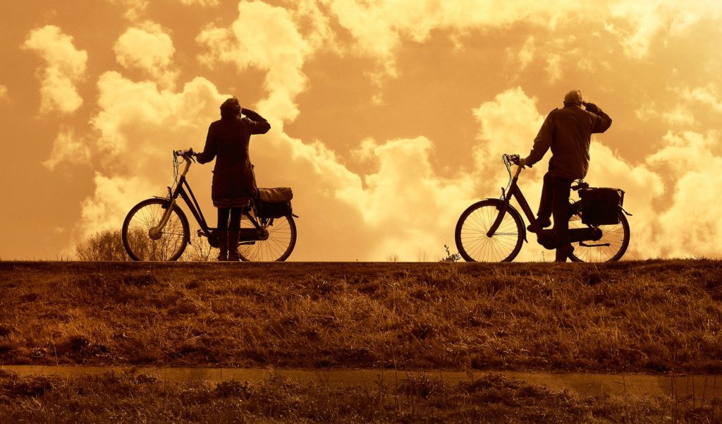 Two Cyclists Watching the Sky