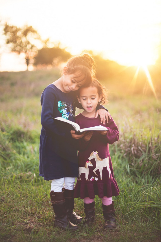 Two Girls Reading the Bible