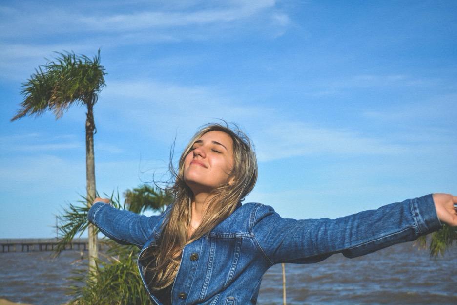 Woman Praising God by the Sea