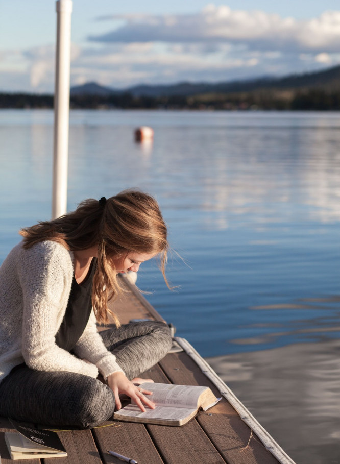 Woman Reading the Bible by the River